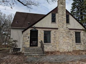 Home with stone veneer needing restoration