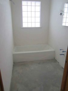 bathroom with plaster restored