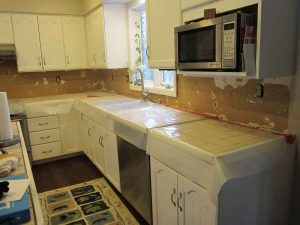 before image of kitchen with plaster
